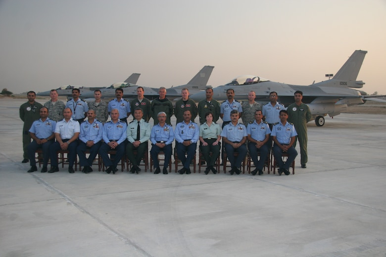 Maj. Bart Van Roo, Lt. Col. Doug Read and Maj. Chris Hansen (back row, center), pose with officials from the Pakistani Air Force after delivering three new F-16s to Shahbaz AB on October 30, 2010.