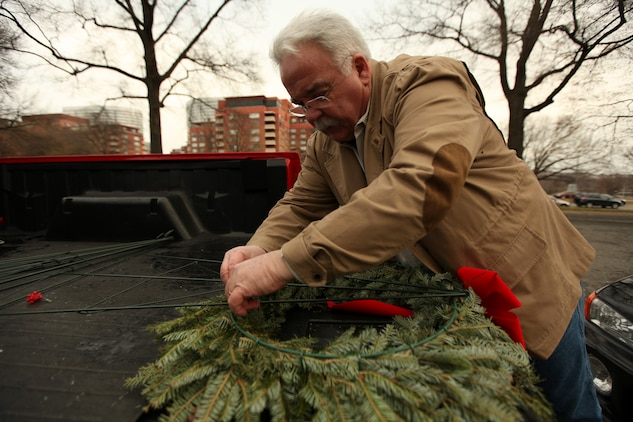 James Donovan, excecutive director of the Marine War Memorial Foundation, prepares a wreath for the 1st Marine War Memorial Christmas wreath laying ceremony December 13, 2010. The wreaths were donated from Augusta County, Va., Christmas tree farms to honor those Marines and servicemembers who have fallen in ongoing and past wars.