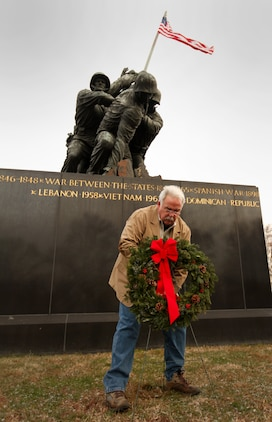 James Donovan, excecutive director of the Marine War Memorial Foundation, lays a wreath during the 1st Marine War Memorial Christmas wreath laying ceremony December 13, 2010.