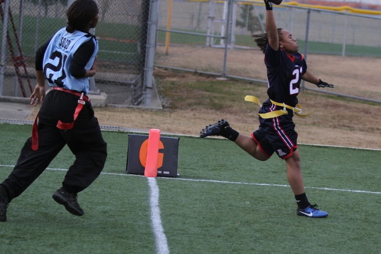Lauryn McCoy scores a touchdown in the championship game against Camp Humphreys II Dec. 5. (Courtesy photo)