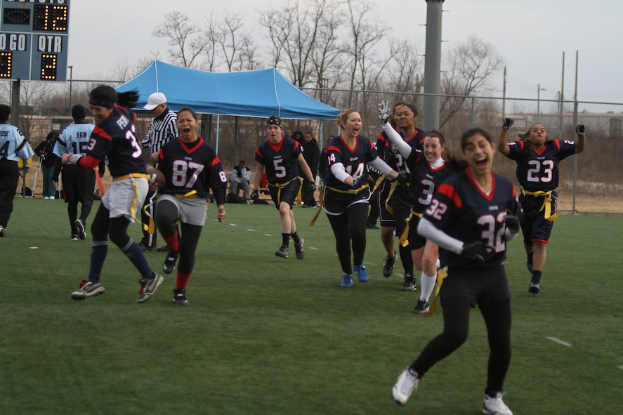 The 'Lady Stangs' celebrate after the final whistle following their 25-12 victory against Camp Humphreys II for the peninsula-wide flag football championship Dec. 5. (Courtesy photo)