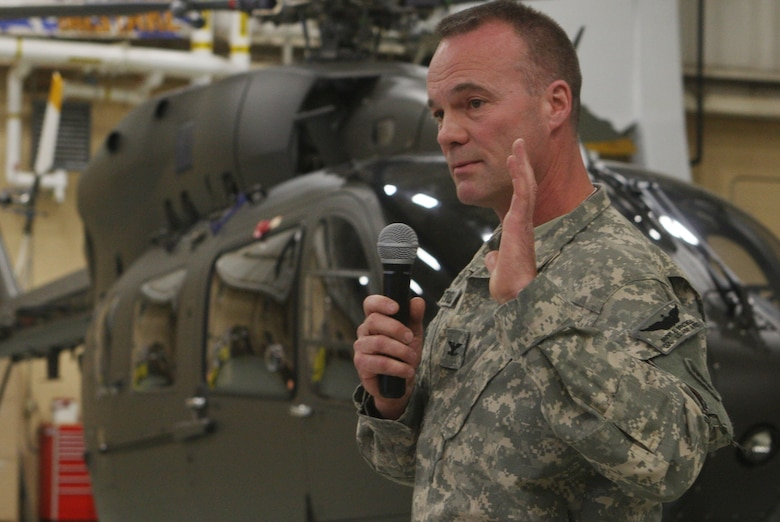 Col. Brent Bracewell, Commander of the 78th Aviation Troop Command, Georgia Army National Guard speaks to a crowd of military and civilian personnel during a UH-72A Lakota Helicopter Delivery Ceremony Dec 3. (U.S. Air Force Photo/Don Peek)