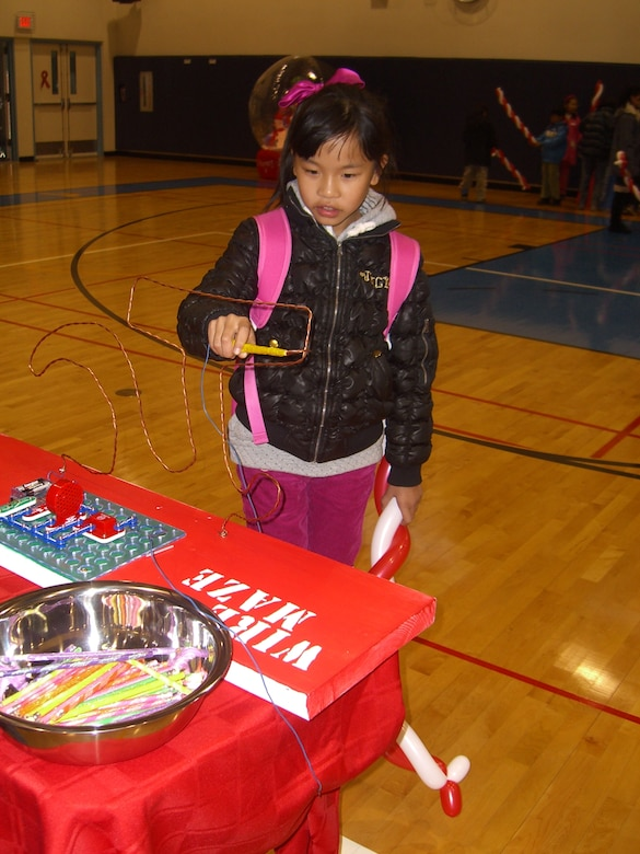 Children participate in games during the Pearl S. Buck Christmas Party at Osan Dec. 4. (Courtesy photo)