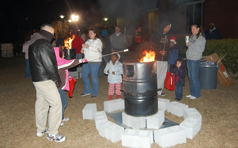 It was a cold night at the Joint Base Charleston-Weapons Station Holiday Festival, Dec. 8, but a bonfire for roasting marshmallows kept party-goers warm. (Photo courtesy David Holt)