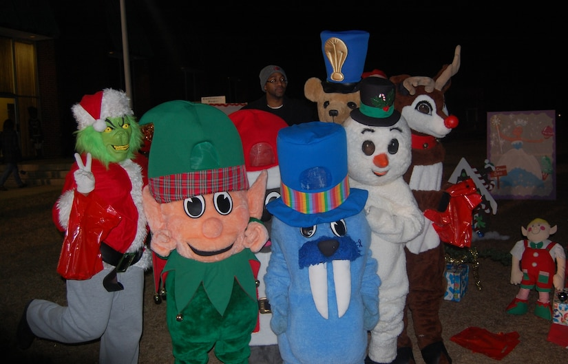 Joint Base Charleston-Weapons Station held its Holiday Festival, Dec. 8 at the Redbank Club. Greeting holiday revelers were volunteers from the base teen center dressed as Chrtistmas legends and the characters from the children's game Candyland.