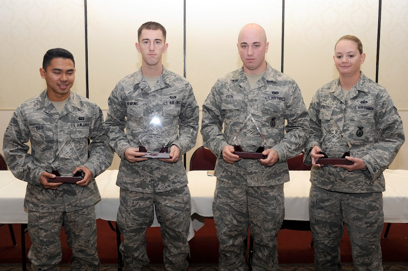 Diamond Sharp winners for December are left to right: Airman 1st class Lakan P. Ello, 628th Force Support Squadron, A1C Tyler J. Wehrung, 628th Communications Squadron, Senior Airman Michael A. Leon, Detachment 3, Navy Brig., and Staff Sgt. Jennifer L. Pentecost, 628th Security Forces Squadron. (U.S. Air Force photo/Staff Sgt. Marie Brown)