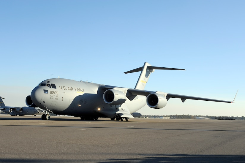 Air Force Lt. Gen. Allen G. Peck taxis in the newest C-17A aircraft on the Joint Base Charleston, S.C., flightline Dec. 9, 2010. The arrival of the aircraft bring the total number of C-17s assigned to the 437th Airlift Wing to 58. General Peck is the Air University commander. (U.S. Air Force photo/Staff Sgt. Marie Brown)
