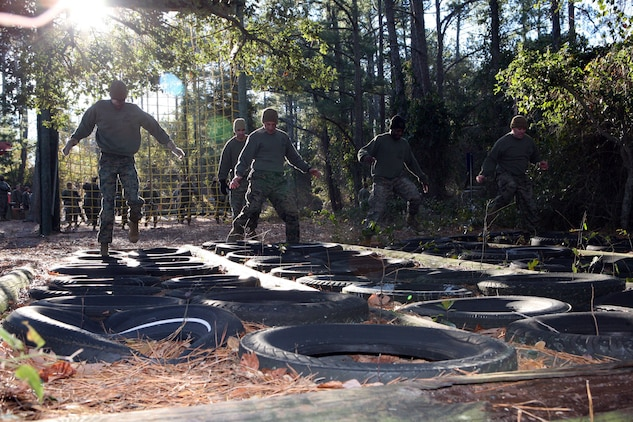 Master Sgt. Lorenzo Merced, communications chief at Marine Forces Command, Gunnery Sgt. James Wells, communications chief at MCTAG, Sgt. Michael Tabb, adjutant chief, Staff Sgt. Daniel Lowe, maintenance chief MARFORCOM and Cpl. Adio Jackman, a communications specialist with MARFORCOM, high stepped through some of the obstacle at the course, Wednesday. Their team placed fourth in the overall competition.