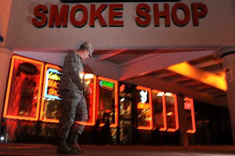 LAS VEGAS -- An Airman leaves a smoke shop near Nellis Air Force Base, Nev. Spice and other mood-altering substances are banned by the Air Force, but were legal to sell in the civilian community until Nov. 24, when the Drug Enforcement Administration used its emergency powers to ban Spice and other products that mimic the effects of marijuana. (U.S. Air Force photo illustration by Tech. Sgt. Michael R. Holzworth)