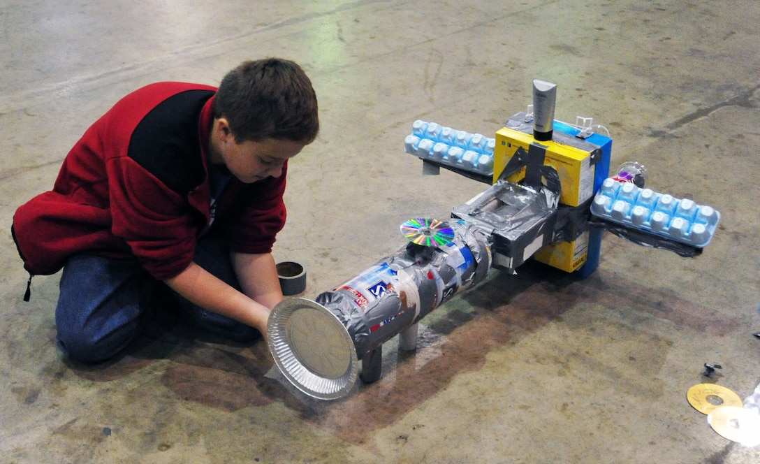 "DAYTON, Ohio (11/2010) -- Children and adults of all ages enjoyed building an ""Intercommunity Space Station"" by adding pieces to a single group-built station during Family Day at the National Museum of the U.S. Air Force. (U.S. Air Force photo)"