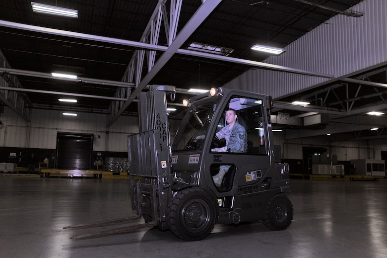 Tech. Sgt. Charles Branum, 62nd Aerial Port Squadron shift supervisor, operates a forklift before securing cargo to pallets Dec. 15 at McChord Field, Joint Base Lewis-McChord, Wash. (U.S. Air Force photo/Adamarie Lewis-Page)
