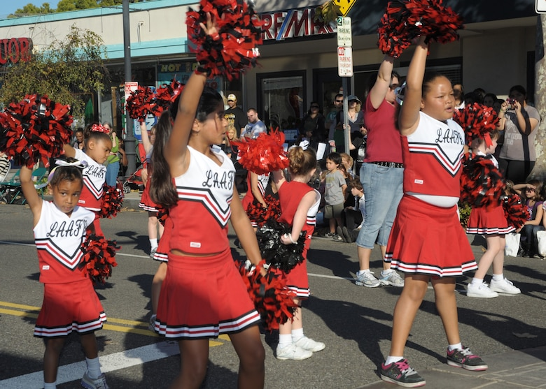 Cheerleaders from LAAFB's Youth Services program cheer for the crowd at  the City of El Segundo's annual holiday parade, Dec. 12. (Photo by Joe Juarez)