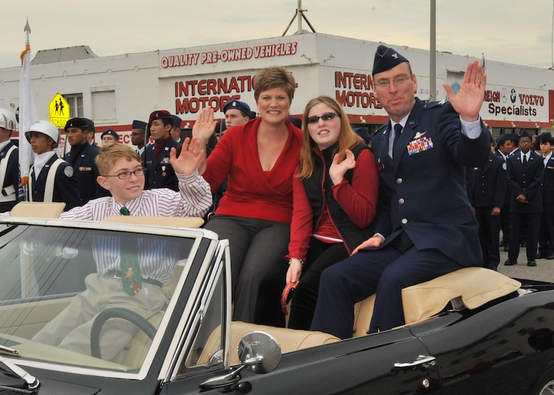 Colonel Frank Simcox, 61st Air Base Group commander, his wife, Susan and children, Caitlin and Frank rode in a vintage car in the San Pedro Holiday Parade, Dec. 6. (Photo by Lou Hernandez)
