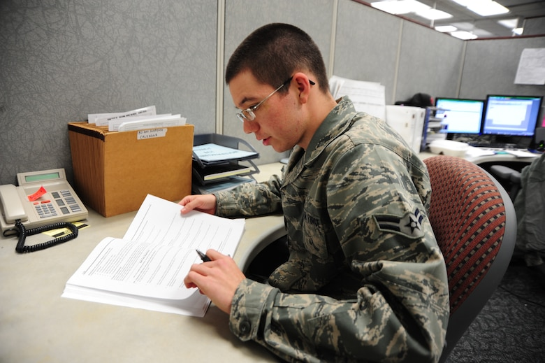Airman 1st Class Billy Baggett, force management apprentice, 42nd Force Support Squadron, 42nd Air Base Wing, Maxwell Air Force Base, Ala. studies his CDCs as he prepares for his end-of-course test. Electronic CDCs for select career fields were made available November 16 and are available as an alternative to paper CDCs for approximately 60 Air Force Specialty Codes. The number of courses available on-line is slated to increase in mid-December. (Air Force Photo/Airman 1st Class Christopher S. Stoltz)