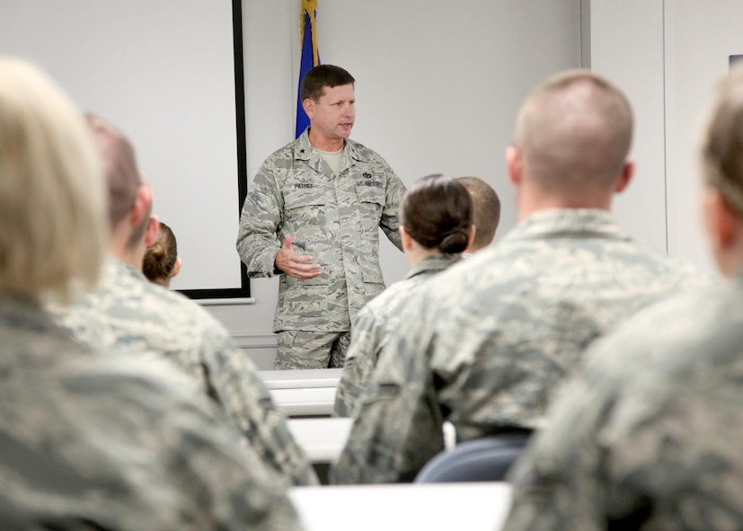 Brig. Gen. Leonard Patrick, 502nd Air Base Wing commander, welcomes new permanent party Airmen to Lackland at the First Term Airmen Center Dec. 15. During his visit, General Patrick talked with the Airmen about the importance of setting goals. FTAC helps Airmen transition from a training environment to their first duty station. (U.S. Air Force photo/Robbin Cresswell)