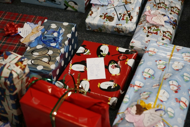 Presents with numbers lined the floor ready to be given away to each of the 51 children from the Yahata Children's home that participated in the 6th annual Marine Corps Exchange angel tree gift exchange at the MCX here Dec. 18.