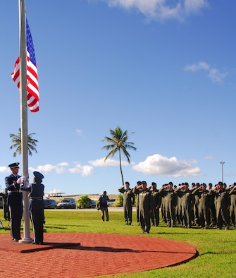 Team Andersen Airmen and audience members render a salute as Taps is played, in honor of the lives of 33 men and women that were lost during Operation Linebacker ll, at a memorial ceremony on Andersen Air Force Base, Guam, Dec. 17.  The ceremony commemorates the 38th anniversary of the campaign that led to the end of the Vietnam War.  (U.S. Air Force photo/Staff Sgt. Jamie Powell)