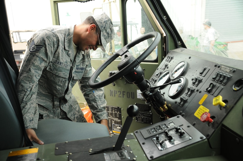 SOTO CANO AIR BASE, Honduras - Staff Sgt. Josue Santiago inspects the inside of a Heavy Expanded Mobility Tactical Truck-M978 A3. Petroleum, Oil and Lubricant shop troops here trained on the new capabilities and functions of their 9 newest fleet additions Dec. 13. (U.S. Air Force photo/Staff Sgt. Kimberly Moore)
