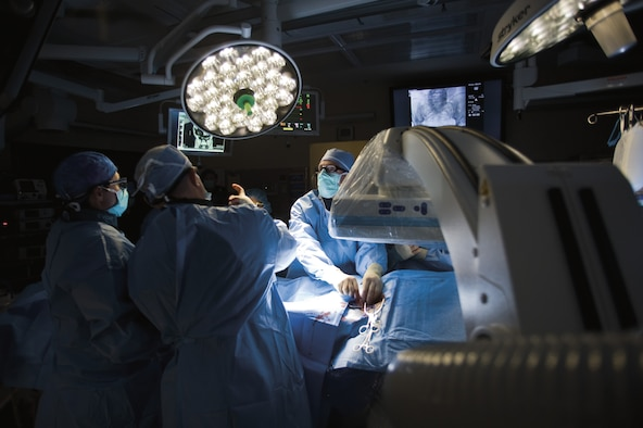 Vascular surgeons perform an abdominal aortic aneurysm repair procedure in the hybrid Cardiovascular Operating Room, located at the David Grant USAF Medical Center on Travis Air Force Base, Calif. U.S. Air Force photo/Tech. Sgt. Bennie J. Davis III)