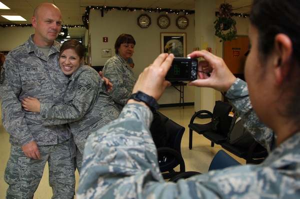 Master Sgt. Robert Gollner, 59th Surgical Inpatient Squadron (left), and Senior Airman Danelia Chairez, 59th Medical Inpatient Squadron, pose for a photo Dec. 22 at the Lackland Air Force passenger terminal. Airman Chairez was one of more than 45 Airmen, the majority from the 59th Medical Wing, who deployed for approximately six months in support of Operation New Dawn.  (U.S. Air Force photo/Senior Airman Corey Hook)