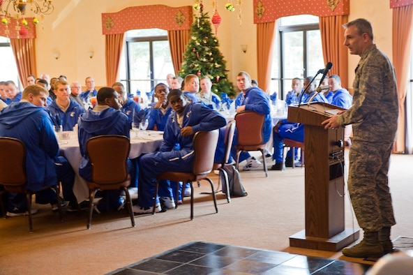 Col. Tim Fay, 2nd Bomb Wing commander, speaks to members of the U.S. Air Force Academy football team and guests from team Barksdale during a lunch on Barksdale Air Force Base, La., Dec. 23. Colonel Fay is a 1987 distinguished graduate of the U.S. Air Force Academy. The team is in town for the AdvoCare V100 Independence Bowl Monday where the Falcons will face the Georgia Tech Yellow Jackets. (U.S. Air Force photo/Senior Airman Chad Warren)