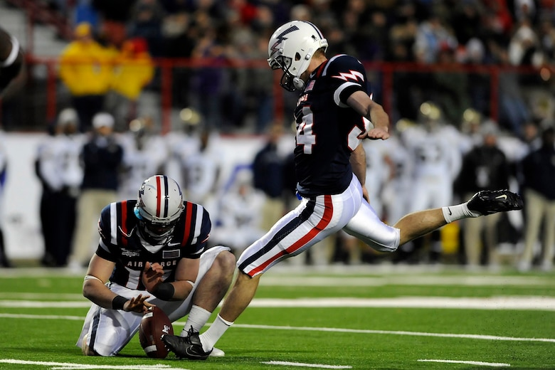 Air Force kicker Zack Bell kicks a 41-yard field goal to give the Falcons their first points of the game in the Advocare V100 Independence Bowl against Georgia Tech Dec. 27, 2010. Bell, a native of Darien, Ill., hit field goals from 41 and 42 yards in the first half, paving the way for a 14-7 Air Force victory. (U.S. Air Force photo/Mike Kaplan)