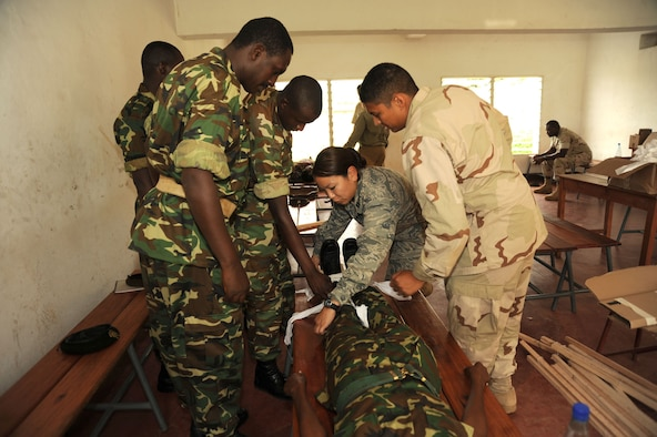 Capt. Sylvia Kim demonstrates how to splint a broken leg to members of the Burundian National Defense Force during a Tactical Combat Casualty Care course Nov. 8, 2010, in Burundi, Africa. Captain Kim is fluent in French, an official language for Burundians, making it easier to communicate with the class. (U.S. Air Force photo/Staff Sgt. Heather Stanton)