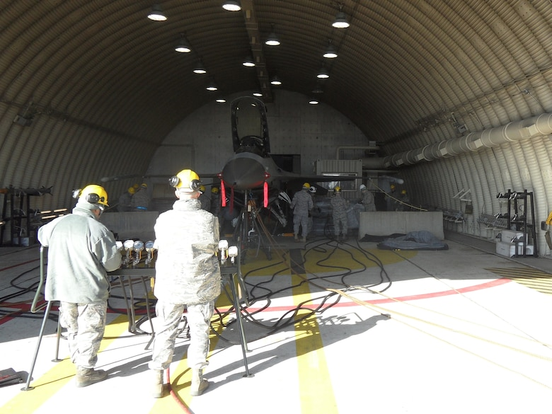 51st Maintenance Squadron Transient Alert Crash Recovery team members conduct an airbag lift operation inside Hanger 18L at Osan AB Dec. 11. (U.S. Air Force photo/Tech. Sgt. Kasey Lynch)