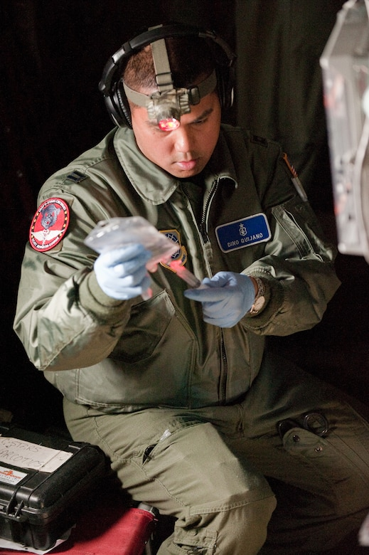 CINCINNATI, OHIO -- Capt. Dino Quijano, a nurse from the 60th Inpatient Squadron at Travis Air Force Base, Calif., prepares simulated narcotics for a training mannequin while airborne Feb 11, 2010. Captain Quijano was participating in a two-week Critical Care Air Transport Team course designed to provide medical personnel with total immersion in the care of severely injured patients. Ground training and simulated-flight training are conducted at the University of Cincinnati, one of four Air Force Centers for Sustainment of Trauma and Readiness Skills (CSTARS) nationwide, but the final day of instruction is provided while airborne in a Kentucky Air Guard C-130. Kentucky's 165th Airlift Squadron began providing C-130s to use as a CSTARS training platform in 2009. (U.S. Air Force by Maj. Dale Greer)