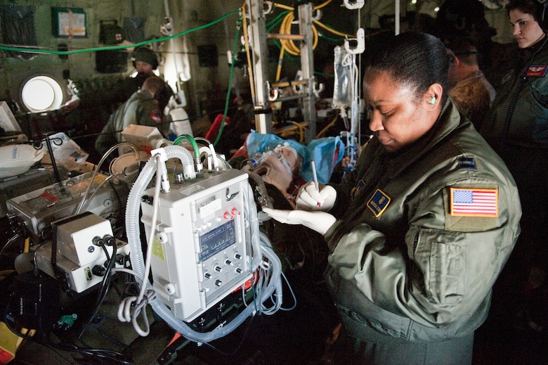 CINCINNATI, OHIO -- Capt. Marsha Starks, a nurse from the 633rd Air Base Wing at Langley Air Force Base, Va., notes the vital signs of a simulated patient while airborne Feb 11, 2010, as 1st Lt. Leann Hisle, a flight nurse from 375th Aeromedical Evacuation Squadron at Scott Air Force Base, Ill., observes. Captain Starks was participating in a two-week Critical Care Air Transport Team course designed to provide medical personnel with total immersion in the care of severely injured patients. Ground training and simulated-flight training are conducted at the University of Cincinnati, one of four Air Force Centers for Sustainment of Trauma and Readiness Skills (CSTARS) nationwide, but the final day of instruction is provided during actual flight aboard a Kentucky Air Guard C-130. Kentucky's 165th Airlift Squadron began providing C-130s to use as a CSTARS training platform in 2009. (U.S. Air Force by Maj. Dale Greer)