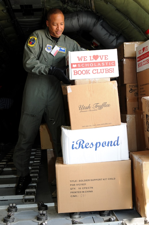 Master Sgt. Eric Henderson, a boom operator from the 151st Operations Group, unloads school supplies for a Moroccan orphanage Jan. 24. The 50 school kits, which were assembled and donated by spouses of the Utah National Guard's senior enlisted leaders, were flown on a Utah ANG KC-135. The aircraft will also participate in the Aeroexpo Marrakech 2010 scheduled for January 27 to 30 in Morocco. U.S. Air Force photo by Airman 1st Class Lillian Chatwin (Unclassified)