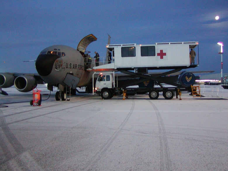 A specialized medical K-Loader prepares to offload patients who have been recently flown in a Utah Air National Guard KC-135 from Bagram Air Base, Afghanistan to Ramstein AB, Germany. Once medical ground crews offload the patients, they will be transported to the Landstuhl Regional Medical Center for further medical treatment. U.S. Air Force photo by Maj. Dan Boyack. (Unclassified)