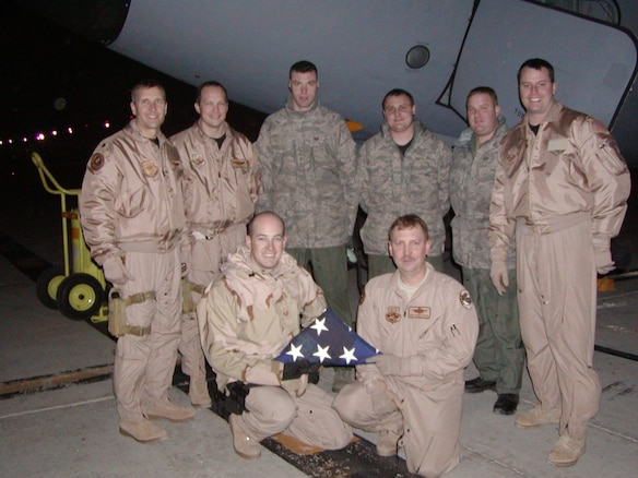 Aircrew members from the 151st Air Refueling Wing pose for a group shot in front of their KC-135 after completing an aeromedical evacuation mission from Ramstein Air Base, Germany to Bagram AB, Afghanistan. With the exception of one boom operator, this was the first AE mission for the entire crew. (Front row): Tech. Sgt. George Kalakis and Master Sgt. Brian Lawson (Back row - left to right) Maj. Corey Love, Maj. Daniel Boyack, Staff Sgt. Enoch Pitzer, Staff Sgt. John Lawson, Tech. Sgt. Jeffrey Hall and 1st Lt. David Geerdes U.S. Air Force courtesy photo (unclassified)