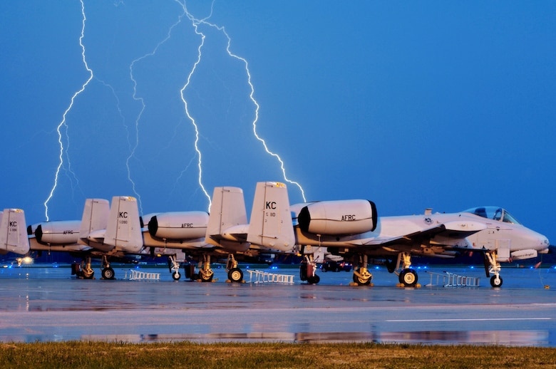Lighting strikes behind A-10 Thunderbolt IIs on the Whiteman Air Force Base, Mo., flightline during an early morning thunderstorm Oct. 20, 2009. The 442nd Fighter Wing maintains a fleet of 27 A-10s. (U.S. Air Force photo/Senior Airman Kenny Holston)