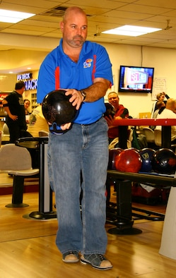 Long-time Tinker bowler Merle Norman takes a look down the lane at the Tinker Bowling Alley recently. Norman has several 300 games and 800 series to his name and is part of the tight-knit bowling community on base.(Air Force photo by Margo Wright)