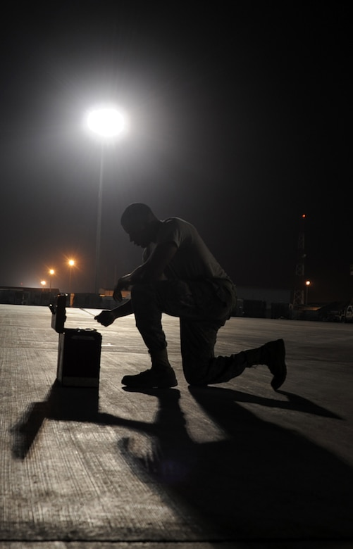 Senior Airman Justin Lassiter, a KC-10 Extender aerospace propulsion journeyman deployed with the 380th Expeditionary Aircraft Maintenance Squadron, reaches into a toolbox while working a night shift at a non-disclosed base in Southwest Asia. Here he is pictured on Jan. 31, 2010.  His primary mission is to fix and maintain KC-10 aircraft engines and systems. He is on his third deployment with the 380th EAMXS. Airman Lassiter is deployed from the 605th Aircraft Maintenance Squadron at Joint Base McGuire-Dix-Lakehurst, N.J., and his hometown is Wilson, N.C. (U.S. Air Force Photo/Master Sgt. Scott T. Sturkol/Released)