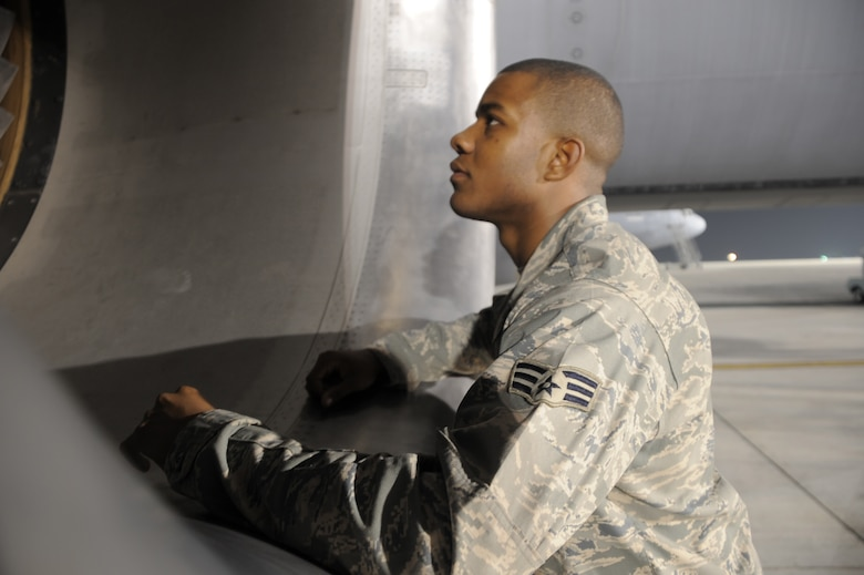 Senior Airman Justin Lassiter, KC-10 Extender aerospace propulsion journeyman deployed with the 380th Expeditionary Aircraft Maintenance Squadron, looks over the engine of a KC-10 at a non-disclosed base in Southwest Asia. His primary mission is to fix and maintain KC-10 aircraft engines and systems. He is on his third deployment with the 380th EAMXS. Airman Lassiter is deployed from the 605th Aircraft Maintenance Squadron at Joint Base McGuire-Dix-Lakehurst, N.J., and his hometown is Wilson, N.C. (U.S. Air Force Photo/Master Sgt. Scott T. Sturkol/Released)