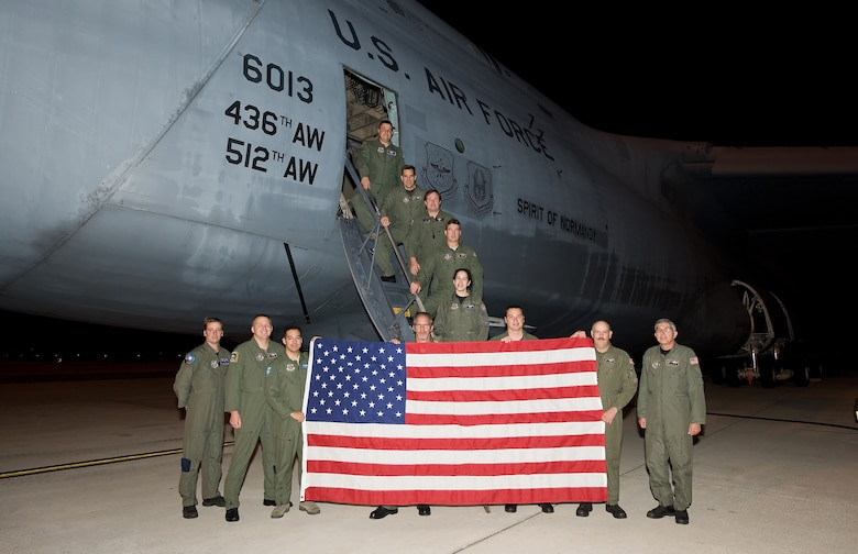 A Dover C-5M Super Galaxy went into the record books Jan. 19 when the F?d?ration A?ronautique Internationale certified 41 world records set by a Sept. 13, 2009, flight. Pictured here are the Team Dover Airmen who flew the record-breaking flight. (U.S. Air Force photo/Jason Minto)