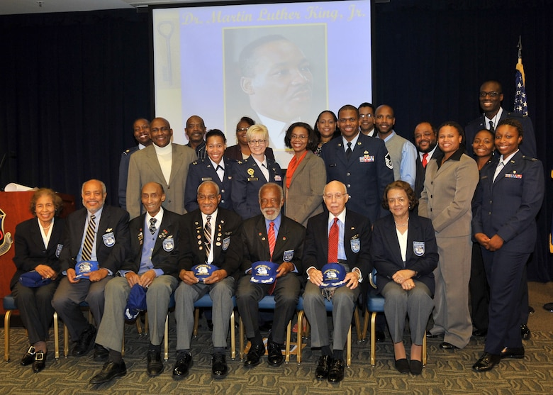 Col. Anita Latin (center), 61st Air Base Wing commander and to her right is Ms. Teri Mathis, Director of Staff office and coordinator for the Dr. Martin Luther King Luncheon held Jan. 14, are joined by  volunteers and staff members.  In front are the serving members of the World War II Tuskegee Airmen. The celebration was held at Los Angeles Air Force Base, Space and Missile Systems Center, El Segundo, Calif. (Photo by  Lou Hernandez)