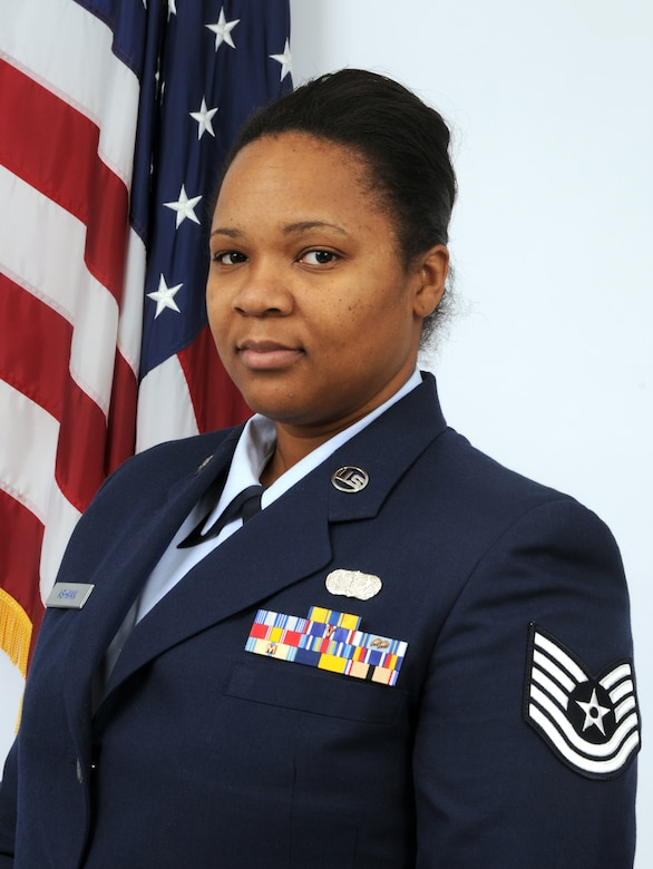 Technical Sgt. Tracy Ashman, a member of the 166th Force Support Squadron, 166th Airlift Wing, New Castle, Del., is the Delaware Air National Guard's FY 2009 Noncommissioned Officer of the Year. Sgt. Ashman, a resident of Bear, Del., is a services specialist in the 166th FSS, and deployed to Southwest Asia for six months in 2003 to Al Minhad Air Base, United Arab Emirates. She is a full-time nurse in the medical intensive care unit at Christiana Hospital, Del., holds an M.B.A. in health care, and is pursuing an additional masters degree in nursing and education. (U.S. Air Force photo/Senior Master Sgt. Gerald Dougherty, Delaware ANG)