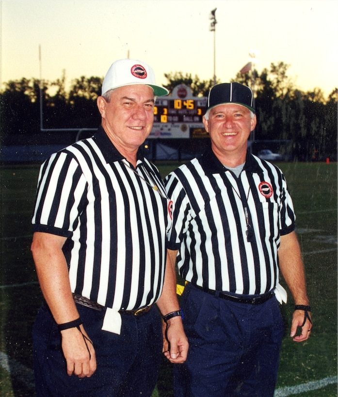 Jack Lamons, left, and Mike McKenzie, a pharmacologist at the Murfreesboro VA Medical Center, pose for a picture before refereeing a game in 2004. (Photo provided)