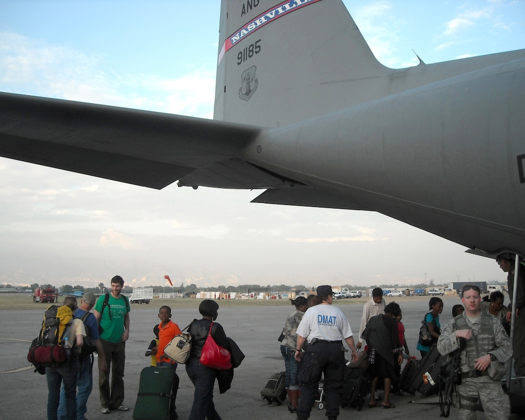 People board one of two 118th Airlift Wing C-130s, January 19, in Haiti to head back to the United States.