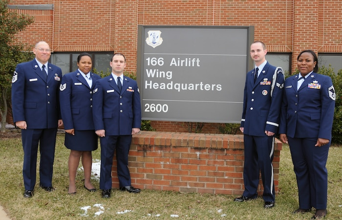 The Delaware Air National Guard's five Outstanding Airmen of the Year for FY 2009, all members of the 166th Airlift Wing located in New Castle, Del., gather in front of wing HQ on Feb. 2, 2010. The Airmen are (L to R): First Sergeant of the Year, Master Sgt. Glenn Davis, 166th Civil Engineer Squadron, and a resident of West Grove, Pa.; Noncommissioned Officer of the Year, Tech. Sgt. Tracy Ashman, 166th Force Support Squadron, and a resident of Bear, Del.; Airman of the Year, Senior Airman Benjamin Fileti, 166th Maintenance Squadron, and a resident of Hockessin, Del.; Honor Guard Member of the Year, Senior Airman Joel Miller, 166th Maintenance Squadron, and a resident of Newark, Del.; Senior Noncommissioned Officer of the Year, Senior Master Sgt. Patrina Obey, 166th Logistics Readiness Squadron, and a resident of Smyrna, Del. (U.S. Air Force photo/Senior Master Sgt. Gerald Dougherty, Delaware ANG)