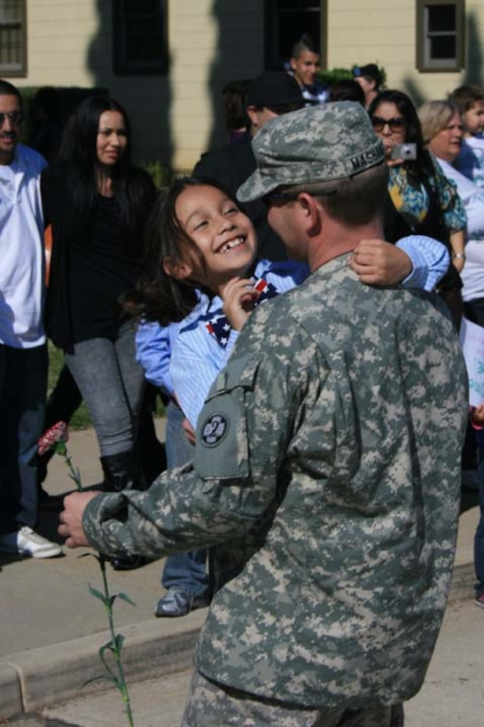 Loved ones welcome home Sgt. Brian Mashaney at the U.S. Army Reserve's 437th Medical Company Ground Ambulance's Welcome Home Warrior-Citizen Ceremony held at March Air Reserve Base, Calif., Feb. 3, 2010.  The 73 Soldiers in the company deployed to Kuwait on March 2, 2009. (U.S. Army photo/Maj. Matthew Lawrence)