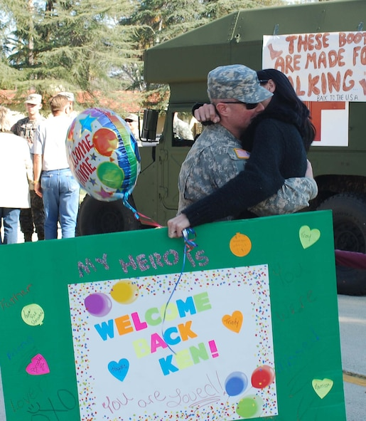 Sfc. Kenneth Donovan hugs his fiance, Taumi Kinney at the U.S. Army Reserve's 437th Medical Company Ground Ambulance' Welcome Home Warrior-Citizen Ceremony held at March Air Reserve Base, Calif., Feb. 3, 2010.  The 73 Soldiers in the company deployed to Kuwait on March 2, 2009. (U.S. Air Force photo/Megan Just)