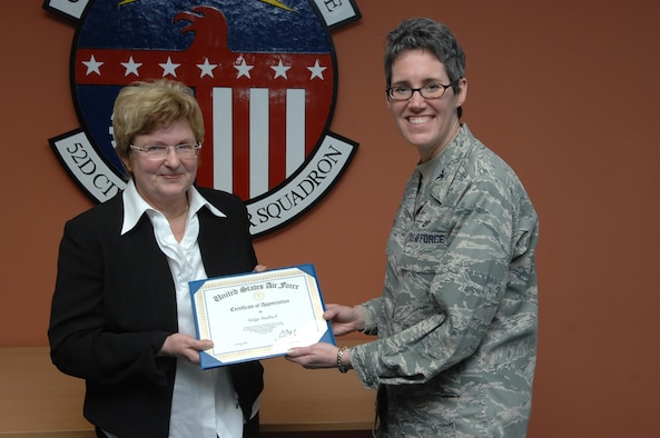 SPANGDAHLEM AIR BASE, Germany -- Col. Jodine Tooke, 52nd Mission Support Group commander, presents a certificate of appreciation to Helga E. Bialluch, retired 52nd Civil Engineer Squadron manpower technician, for her 43 years of dedication and service to Spangdahlem Air Base during her retirement ceremony Jan. 29 in the 52nd CES conference room. Mrs. Bialluch's job was significant to the Air Force and 52nd Fighter Wing because she was responsible for all 52nd CES manpower resources. (U.S. Air Force photo/Airman 1st Class Nick Wilson)