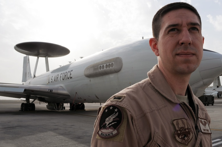 First Lt. Tony Duke is an E-3 Sentry Airborne Warning and Control System aircraft air weapons officer with the 965th Expeditionary Airborne Air Control Squadron deployed to a non-disclosed base in Southwest Asia.  As an air weapons officer, he provides airspace battle management over places like Afghanistan to execute tactical control and employment of all assigned aircraft operating in that area. Lieutenant Duke is deployed from the 965th AACS at Tinker Air Force Base, Okla., and his hometown is Lubbock, Texas. (U.S. Air Force Photo/Master Sgt. Scott T. Sturkol/Released)