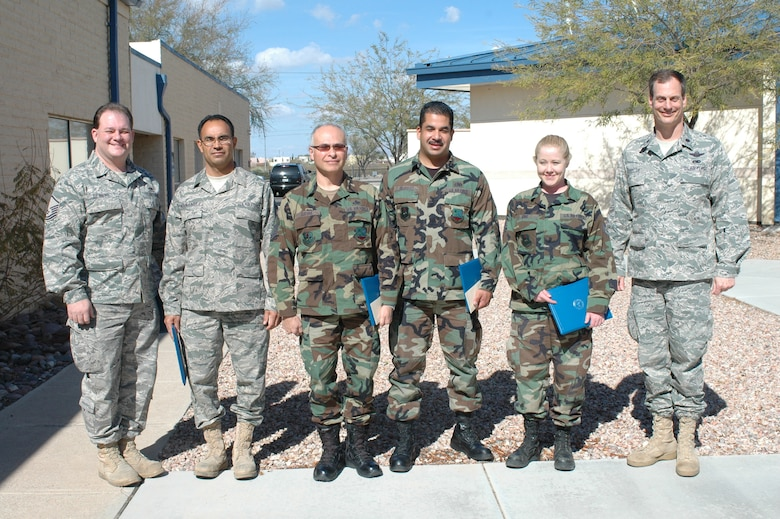 L-R:  Master Sgt. Jeffrey DeBuhr, Tech. Sgt. Fredrick Hernandez, Master Sgt. Fernando Cuevas, Staff Sgt. Saul Dojaquez, and Staff Sgt. Lena King were recognized by Lt. Col. James Taylor, (far right) as the 162nd Maintenance Group Top Performers for this quarter.  The ceremony took place Feb. 4. (Air Force photo by Maj. Gabe Johnson)