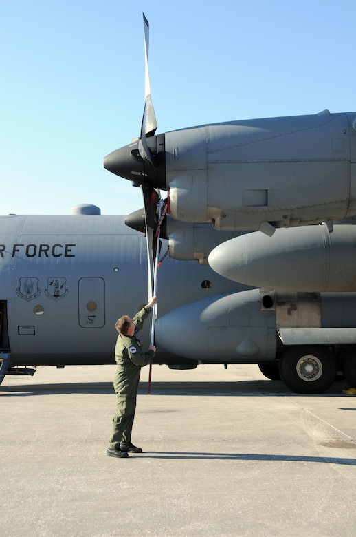 107th AW load master Senior Master Sgt. Thomas Obrochta readies a C-130 for flight. The sergeant volunteered along with other aircrew in support of Operation Unified Relief. (U.S. Air Force photo/staff Sgt. Peter Dean)