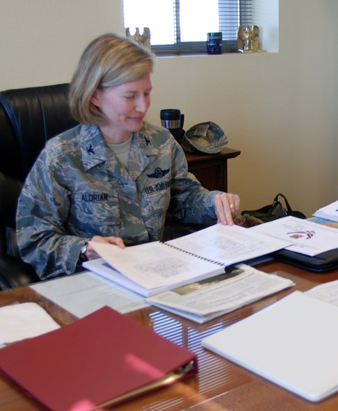 Col. Mary Aldrian, 452nd Air Mobility Wing vice commander, works at her desk in the wing headquarters building during the B UTA weekend, Jan. 24. (U.S. Air Force photo by Staff Sgt. Megan Crusher)